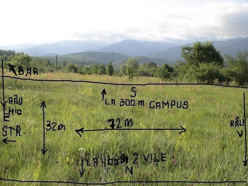 Vand 2300 m.p.teren zona turistica cu utilitati,rau,padure,munte,str.asfalt.intravilan